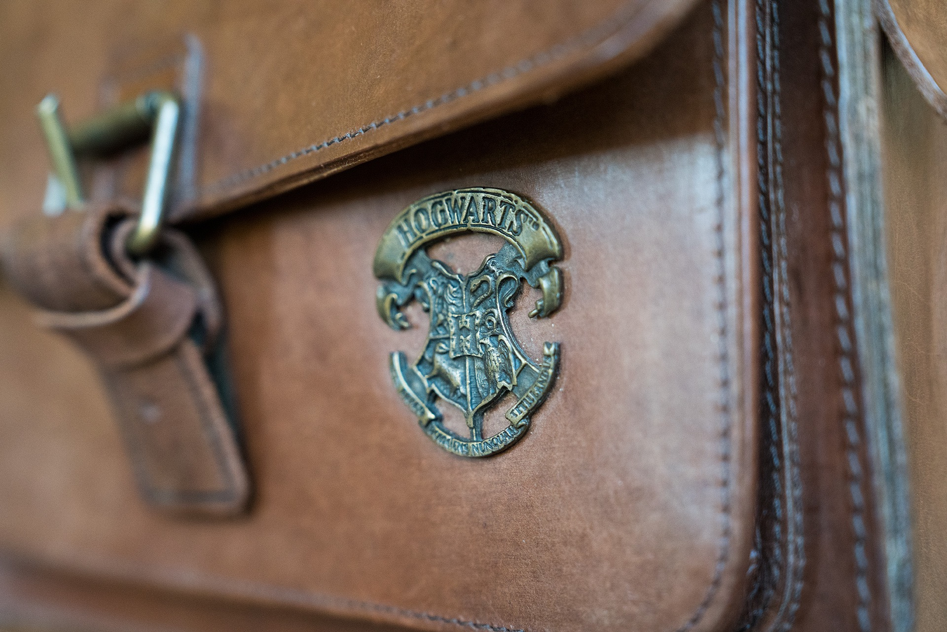 Harry Potter emblem on leather satchel