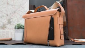 Business tan leather briefcase with back pocket.