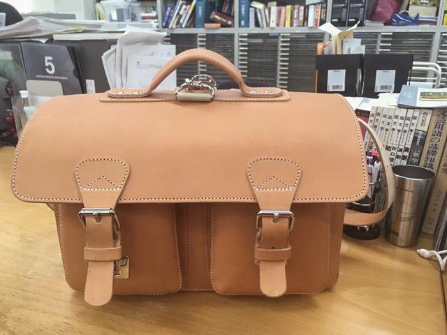 Tan leather satchel that belongs to a Professor.